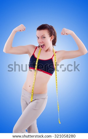 Young girl with centimeter in dieting concept - stock photo