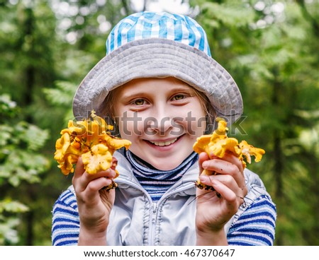 Young girl with chanterelle mushrooms.