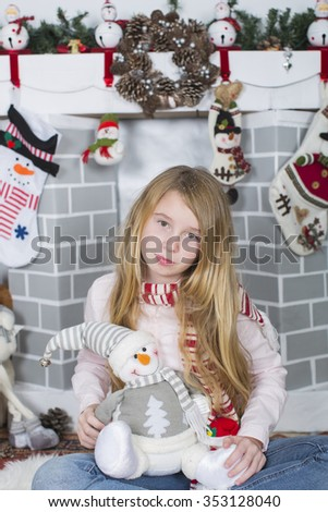 young girl with christmas decorations