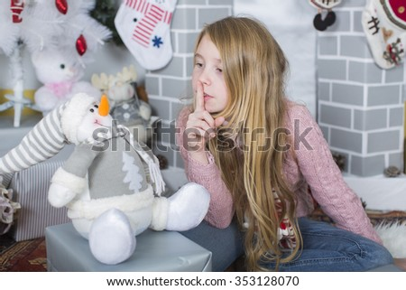 young girl with christmas decorations. little girl with christmas gifts