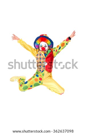 Young girl with clown costume jumping isolated in white - stock photo