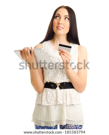 Young girl with credit card and tablet PC isolated - stock photo
