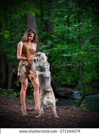 Young girl with dog at forest - stock photo