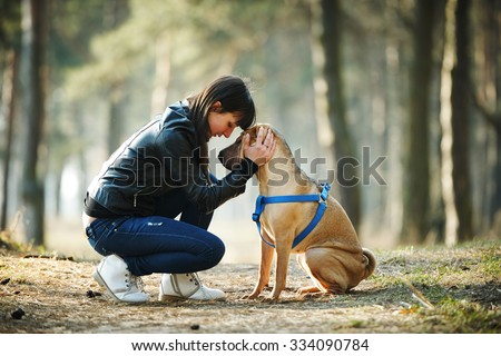 Young girl with dog in the park - stock photo