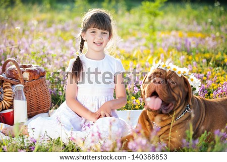 Young girl with dog on field