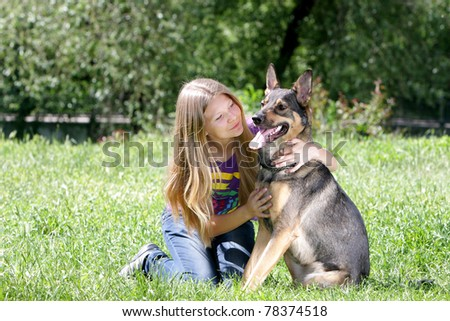 young girl with dog outdoors - stock photo