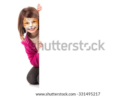 Young girl with face-paint and a white board
