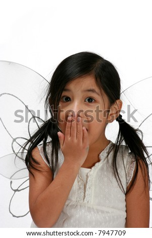 Young girl with fairy wings looking surprised - stock photo