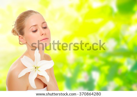 Young girl with flower on spring floral background - stock photo