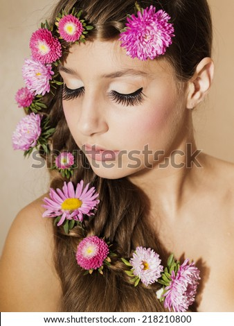 young girl with flowers in hair