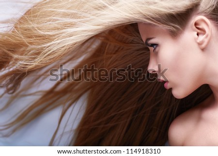 Young girl with flying hair - stock photo