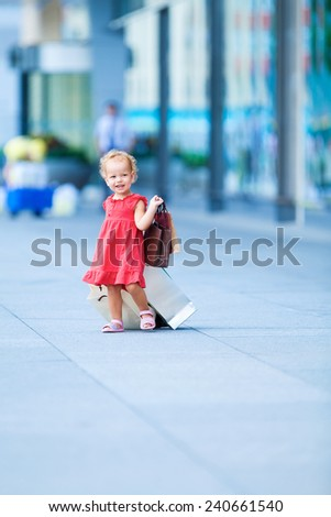 Young girl with full of bags - stock photo