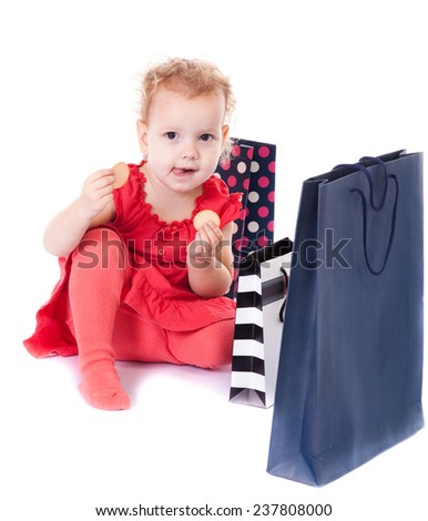 Young girl with full of bags isolated on white background - stock photo