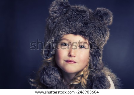 Young girl with fur winter hat - stock photo