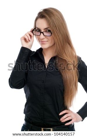 Young girl with glasses looks and smiles