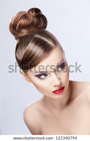 Young girl with hair and makeup on white background - stock photo