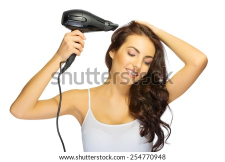 Young girl with hair dryer isolated - stock photo