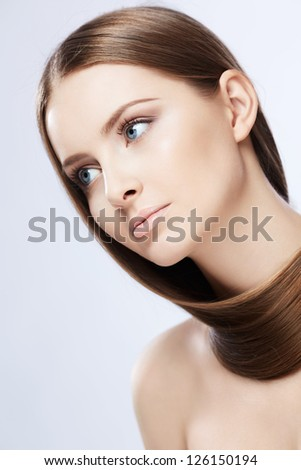 Young girl with hair on white background - stock photo