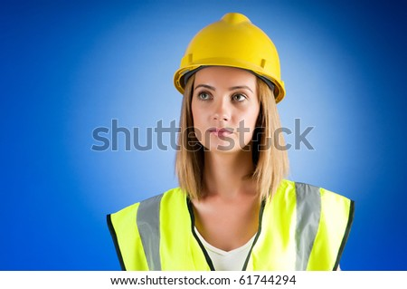 Young girl with hard hat against background