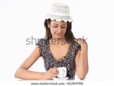 Young girl with hat and cup of coffee