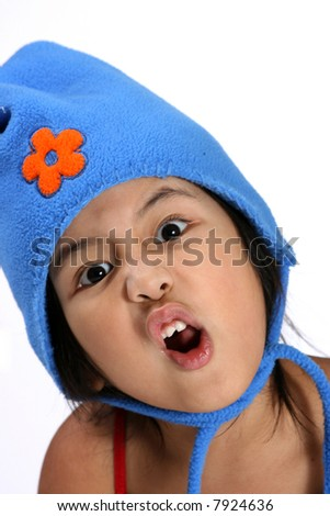 Young girl with hat making silly face - stock photo