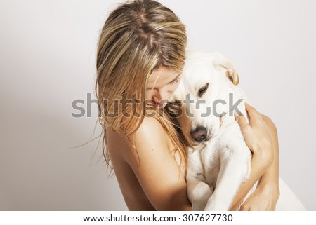 young girl with her dog, studio shot. Horizontal. Copy space for your text. - stock photo