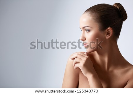 Young girl with her hair in a bun - stock photo