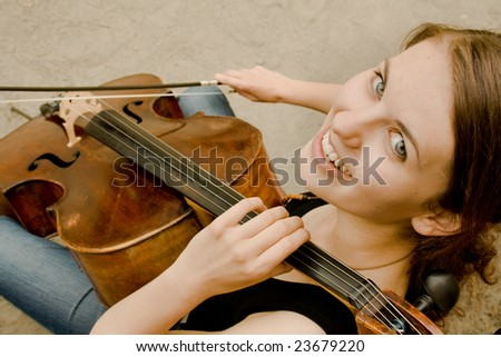 Young girl with instrument - stock photo