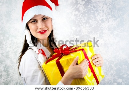 Young girl with joyful expression holding her present - stock photo