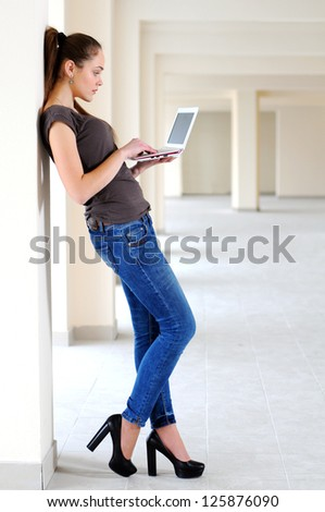 Young girl with laptop - stock photo