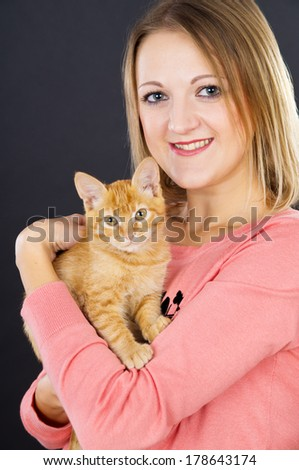 Young girl with little kitten - stock photo