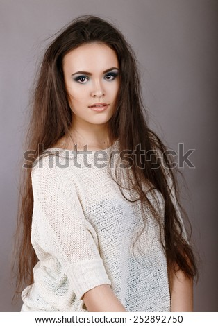 young girl with long unkempt hair. Glamor closeup portrait of beautiful  stylish caucasian young woman model with bright makeup,  with perfect clean skin - stock photo