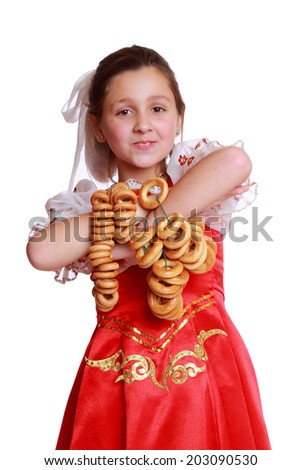 young girl with lovely smile wearing traditional russian costume