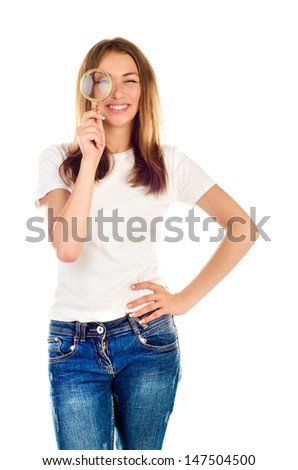 young girl with magnifying glass isolated on a white background - stock photo