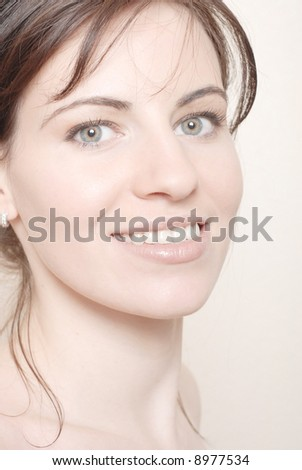Young girl with make up on white - stock photo