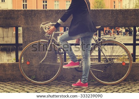 Young girl with old bicycle. - stock photo