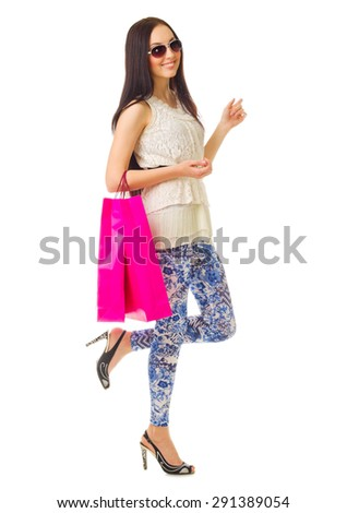 Young girl with paper bags isolated