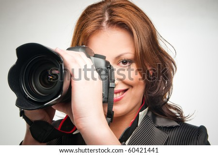 young girl with photocamera isolated on white