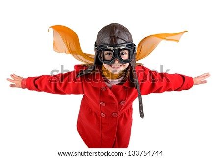 Young girl with pilot goggles and hat isolated in white - stock photo