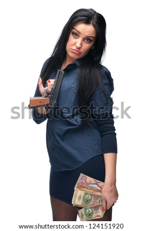 Young girl with pistol and old money on a white background - stock photo