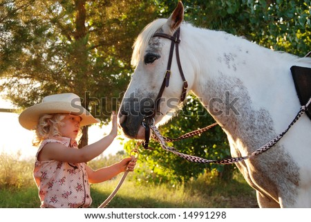 Young girl with pony. - stock photo