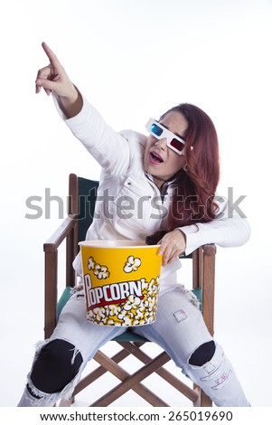 young girl with popkorn and 3D glasses on white background - stock photo