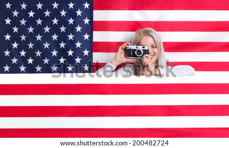 Young girl with retro camera - stock photo