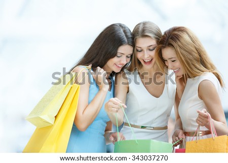 Young girl with shopping bags - stock photo