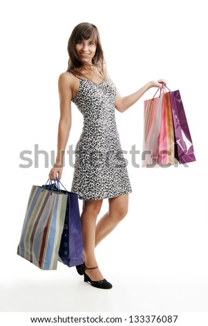 Young girl with shopping bags isolated on white