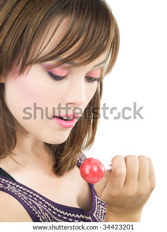 young girl with small pink candy on stick