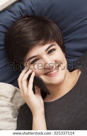 young girl with smart phone - stock photo