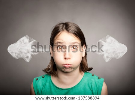 young girl with smoke on her ears - stock photo