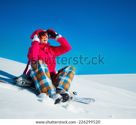 Young girl with snowboard on the snow   - stock photo