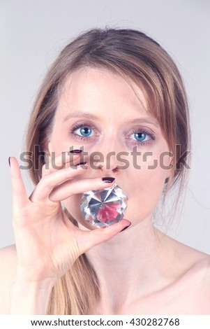 Young girl with sparkling diamond inside her mouth